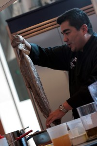 Chef Jose Garces preparing octopus at Chicago Gourmet