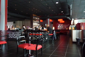 The lounge and bar area at the ICON theater in the VIP balcony.